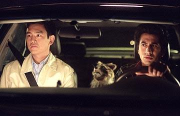 John Cho as Harold and Kal Penn as Kumar with their surprise stowaway in New Line's Harold & Kumar Go to White Castle