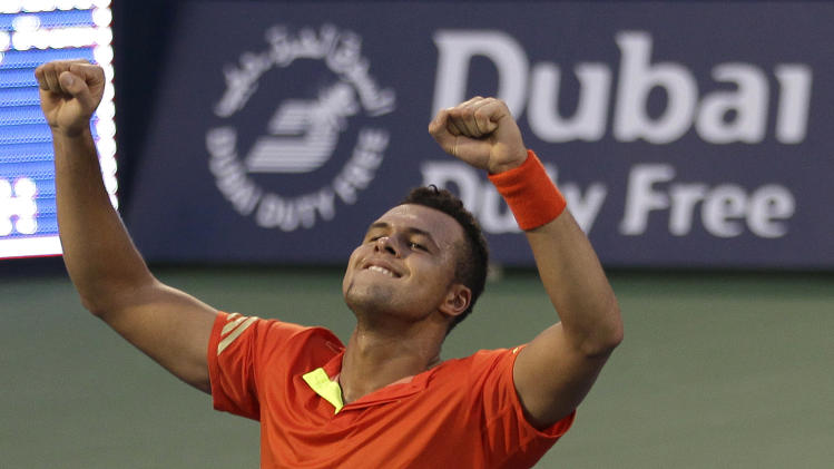 Jo-Wilfried Tsonga of France celebrates  after defeating Marcos Baghdatis from Cyprus during the Emirates Dubai ATP Tennis Championships in Dubai, United Arab Emirates, Tuesday, Feb. 28, 2012. (AP Photo/Hassan Ammar)