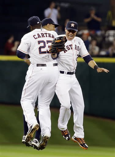 Astros strong in AL debut, top Texas in MLB opener