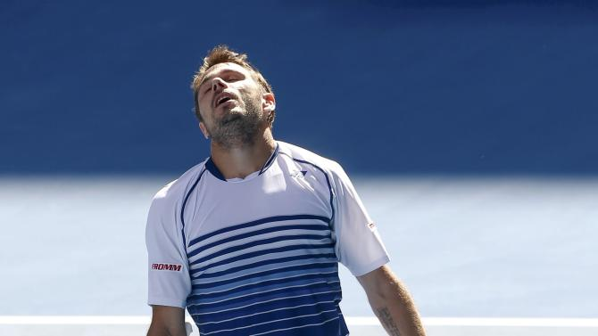 Stan Wawrinka of Switzerland reacts after defeating Kei Nishikori of Japan in their men's singles quarter-final match at the Australian Open 2015 tennis tournament in Melbourne