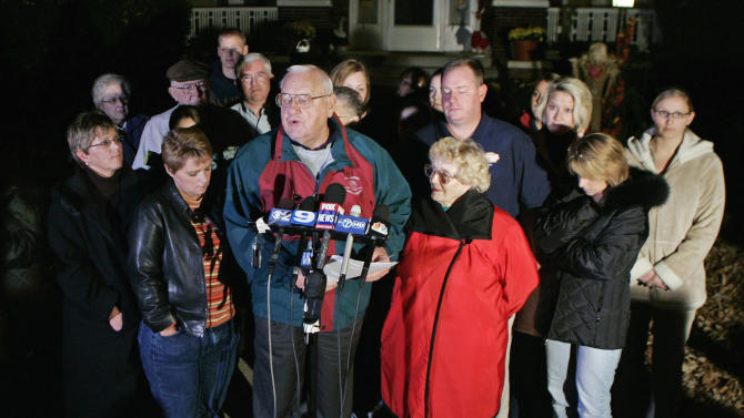 FILE - In this Nov. 6, 2007 file photo, former Illinois Gov. George Ryan speaks to reporters outside his home in Kankakee, Ill., as his wife, Lura Lynn, center right, and family and friends look on after a bid to to delay the start of his prison sentence failed. He reported to prison the following day. Ryan is scheduled to be released from a Terre Haute, Ind., prison Wednesday, Jan. 30, 2013, and enter a halfway house in Chicago. Both his wife and a brother died while he was in prison. (AP Photo/Jerry Lai, File)