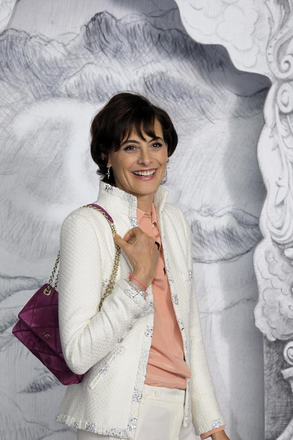 Ines de la Fressange, businesswoman and former model arrives for the show of Chanel by fashion designer Karl Lagerfeld during his Women's Fall Winter 2013 haute couture fashion collection in Paris, France, Tuesday, July 3, 2012. (AP Photo/Francois Mori)