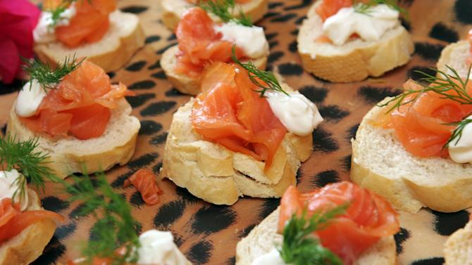 FILE- This Sunday, Dec. 2004 file photo, shows smoked salmon on toasted rye rounds with dilled cream cheese and sour cream. Smoked salmon tainted with salmonella bacteria has sickened hundreds of people in the Netherlands and the United States, sparking a major recall health authorities said Tuesday, Oct. 2, 201. (AP Photo/Mike Hentz, File)