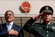 US Secretary of Defense Leon Panetta (L) stands at attention during the national anthem, next to China&#39;s Defense Minister Liang Guanglie at the Bayi Building in Beijing, on September 18. Panetta, who was in Tokyo the day before, was to deliver an appeal for calm in talks with senior Chinese military leaders amid an escalating territorial dispute between Beijing and Tokyo