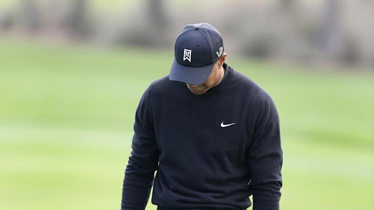 Tiger Woods reacts after hitting the ball into a bunker on the fourth hole during the third round of the Honda Classic golf tournament, Saturday, March 2, 2013 in Palm Beach Gardens, Fla. (AP Photo/Wilfredo Lee)