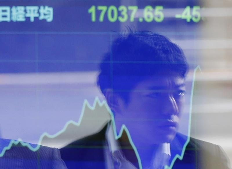 Asian shares tripped up by surprisingly bullish Fed