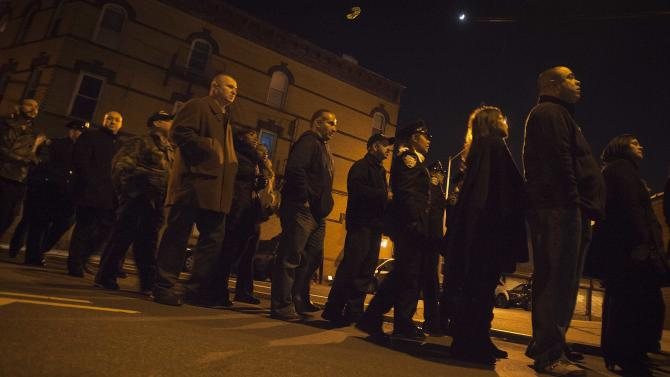 Mourners line up late into the evening for the wake for NYPD officer Rafael Ramos at Christ Tabernacle Church in the Queens borough of New York