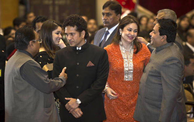 India's cricket icon Sachin Tendulkar, center left, attends an awards ceremony with his wife Anjali Tendulkar, center right, at the Presidential Palace in New Delhi, India, Tuesday, Feb. 4, 2014.