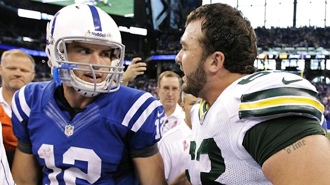 Indianapolis Colts quarterback Andrew Luck, left, is congratulated by Green Bay Packers center Jeff Saturday following an NFL football game in Indianapolis, Sunday, Oct. 7, 2012. The Colts won 30-27. (AP Photo/Michael Conroy)