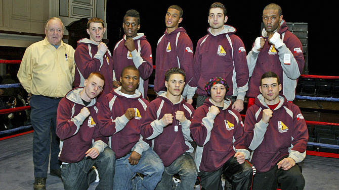 In this Feb. 17, 2010, photo, Tamerlan Tsarnaev, second from right, top row, stands with his team at the 2010 New England Golden Gloves Championship in Lowell, Mass. According to accounts from friends and relatives, Tsarnaev, who came to this country in his mid-teens, had a more difficult time fitting in than his younger brother. He once told a journalist that he had no American friends. And yet when he returned to his homeland last year, relatives said he had trouble fitting in there, too - that he seemed more American than Chechen. (AP Photo/The Sun of Lowell, Julia Malakie) MANDATORY CREDIT: THE SUN OF LOWELL, JULIA MALAKIE