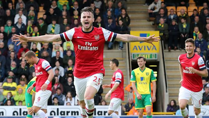 Arsenal's English defender Carl Jenkinson celebrates scoring during the English Premier League football match between Norwich City and Arsenal at Carrow Road on May 11, 2014