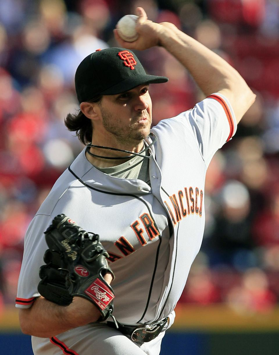 San Francisco Giants starting pitcher Barry Zito throws against the Cincinnati Reds in the first inning of Game 4 of the National League division baseball series, Wednesday, Oct. 10, 2012, in Cincinnati. (AP Photo/Al Behrman)