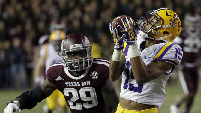 LSU wide receiver Malachi Dupre (15) catches a pass for a first down as Texas A&M defensive back Deshazor Everett (29) defends during the fourth quarter of an NCAA college football game Thursday, Nov. 27, 2014, in College Station, Texas. LSU won 23-17. (AP Photo/David J. Phillip)