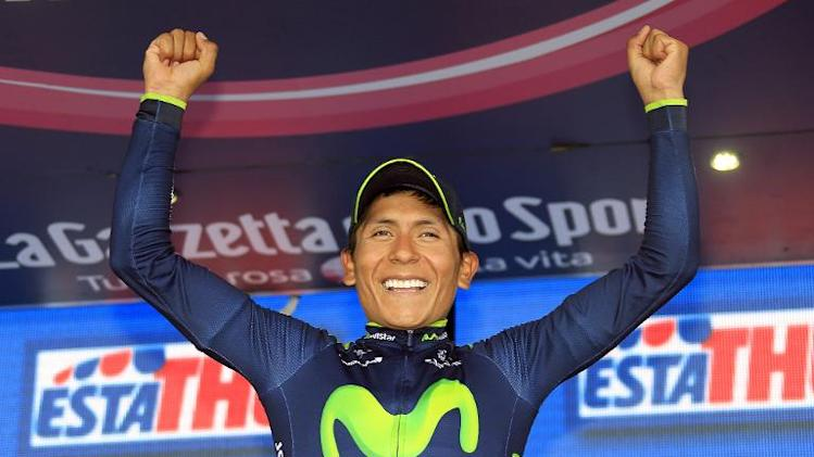 Colombian cyclist Nairo Quintana celebrates his victory on the podium after the Giro d'Italia cycling race from Bassano del Grappa to Cima Grappa on May 30, 2014