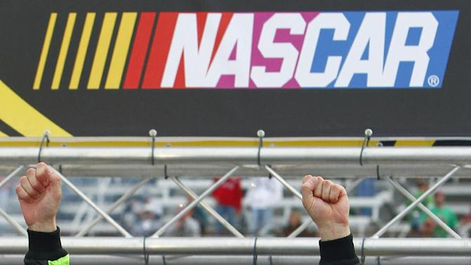 NASCAR Sprint Cup Series driver Kasey Kahne (5) celebrates after winning the Food City 500 auto race, Sunday, March 17, 2013, in Bristol, Tenn. (AP Photo/Wade Payne)