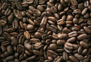 Coffee beans are seen as they are being packed for export in Medan