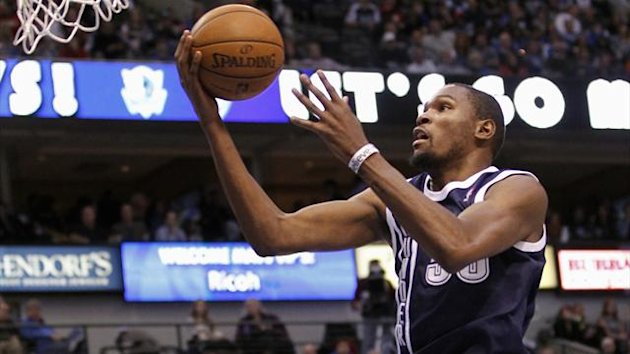 Oklahoma City Thunder forward Kevin Durant shoots the ball as Dallas Mavericks guard O.J. Mayo watches during the second half of their NBA basketball game in Dallas, Texas (Reuters)