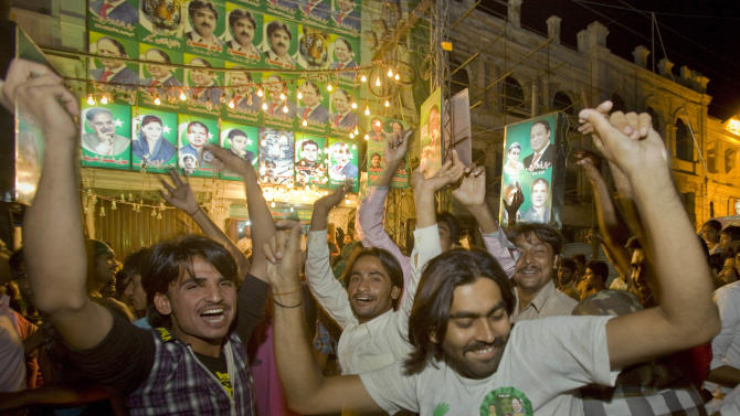 Supporters of Pakistan Muslim League-N party celebrate the primary unofficial results of the country's parliamentary elections at a party office in Lahore, Pakistan, Saturday, May 11, 2013. The Pakistan Muslim League-N party, led by two-time Prime Minister Nawaz Sharif, has long been considered the front-runner in the race. The party appeared to be moving toward a significant victory Saturday based on partial vote counts announced by Pakistan state TV. (AP Photo/Anjum Naveed)