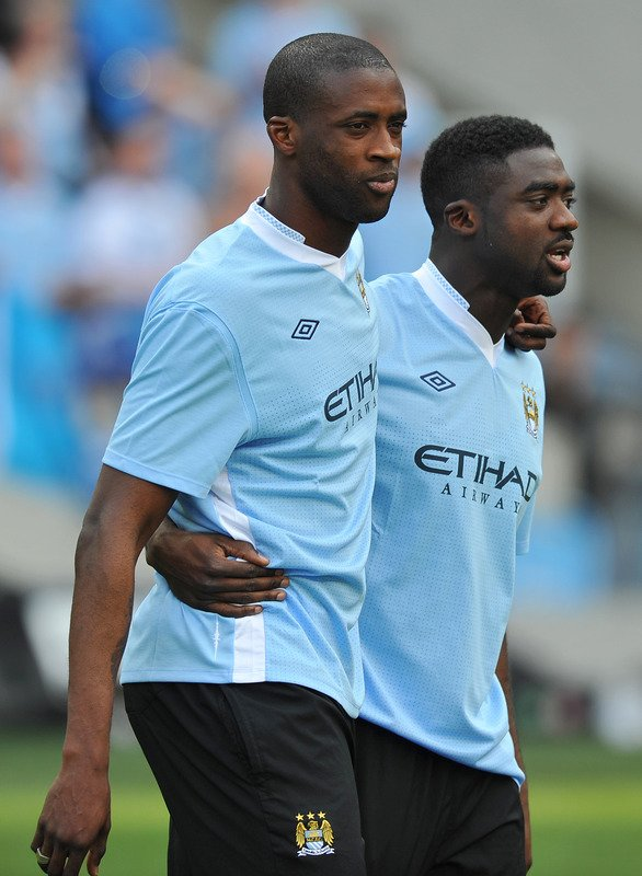 Manchester City's Ivorian Midfielder Yaya Toure (L) Celebrates With His Brother Kolo Toure (R) On The Pitch    AFP/Getty Images