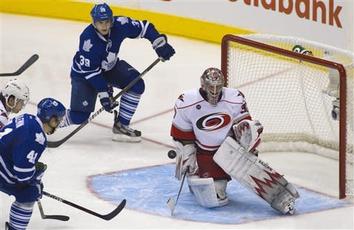 Maple Leafs slip past Canes in OT