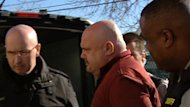 Malcolm Stephen Beaton, centre, is escorted into Dartmouth provincial court on Friday.