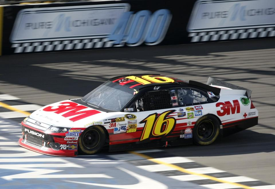 Greg Biffle crosses the finish line to win the NASCAR Sprint Cup Pure Michigan 400 auto race at Michigan International Speedway Sunday, Aug. 19, 2012, in Brooklyn, Mich.  (AP Photo/Bob Brodbeck)