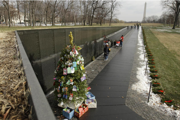 A Christmas tree decorated with cards from around the country is placed at the apex of the Vietnam Veterans Memorial in Washington, on Monday, Dec. 20, 2010. (AP Photo/Jacquelyn Martin)