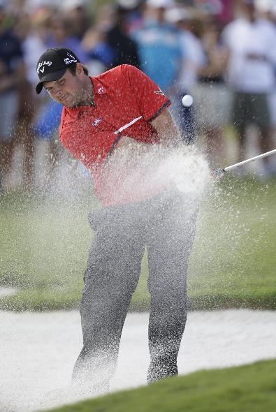 Patrick Reed hits from an eighth hole sand trap during the final round of the Cadillac Championship golf tournament on Sunday, March 9, 2014, in Doral, Fla