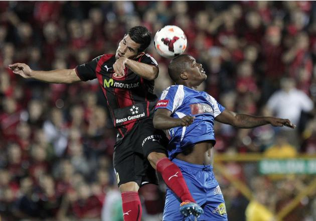 Sanchez of Costa Rica's Alajuelense jumps for the ball with Hormechea of Panama's Arabe Unido during their CONCACAF Champions League soccer match at Alejandro Morera Soto Stadium in Alajuela