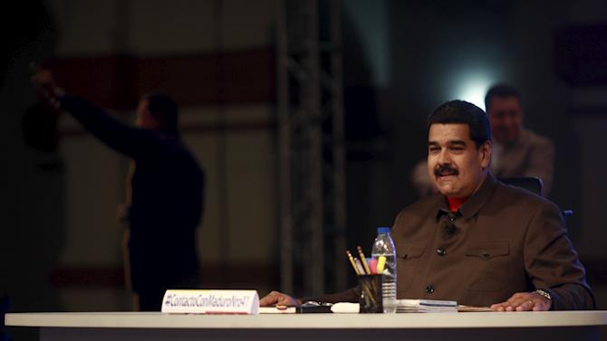 "Venezuela's President Nicolas Maduro smiles during his weekly broadcast ""In Contact with Maduro"" in Caracas"