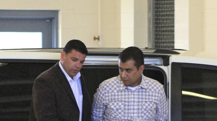 After his bond was revoked, George Zimmerman, right,  returns to the John E. Polk Correctional Facility in Sanford, Fla., Sunday, June 3, 2012.  Zimmerman is charged with second-degree murder in the shooting of Trayvon Martin. (AP Photo/Orlando Sentinel, Joshua C. Cruey, Pool)