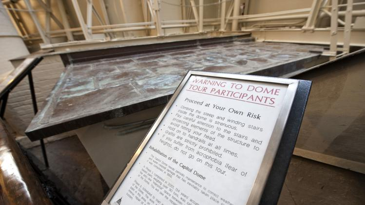 A sign warns visitors of the risks in visiting the upper reaches of the US Capitol dome on Capitol Hill in Washington