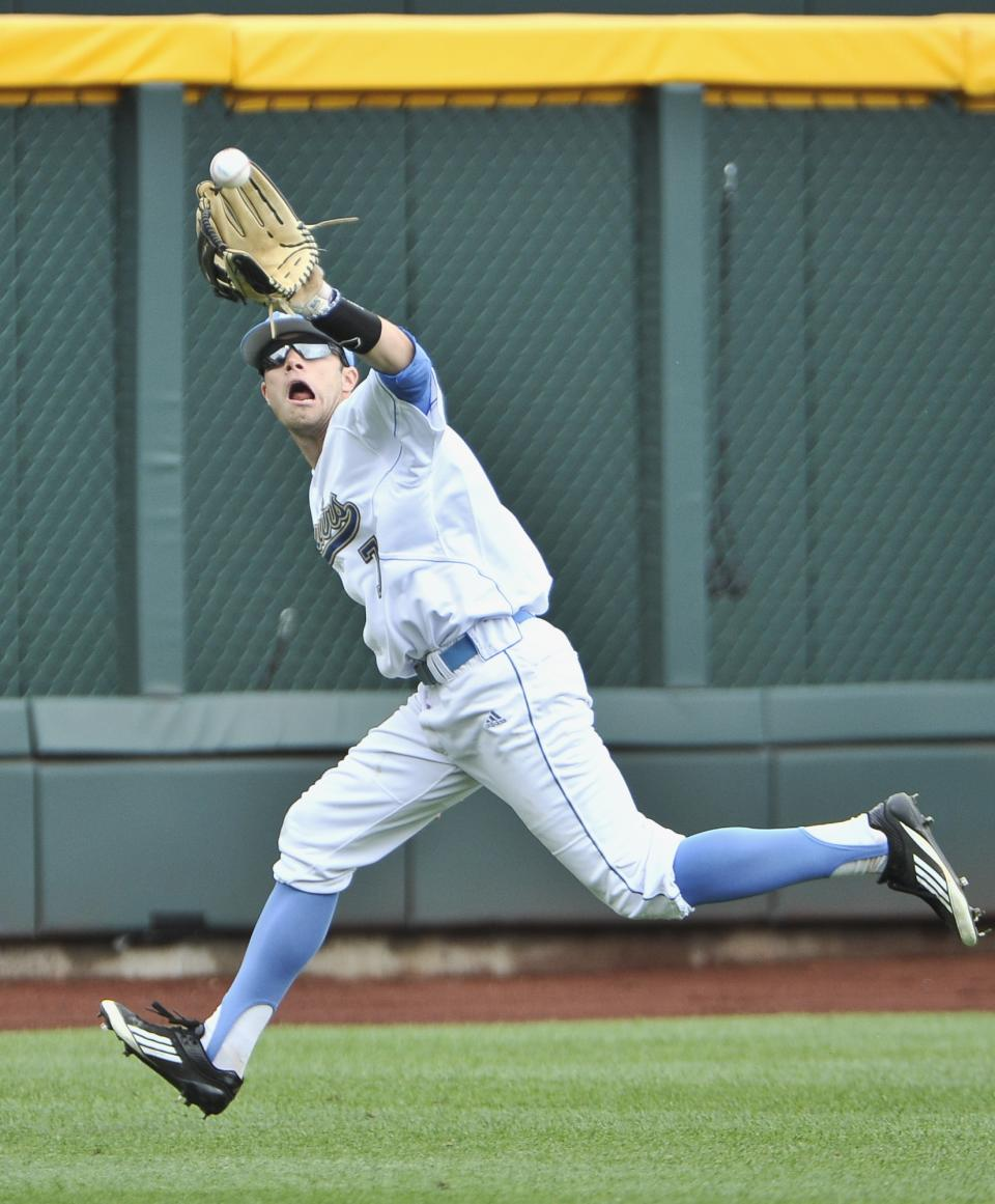 UCLA outfielder Cody Keefer catches a flyball hit by Stony Brook's Pat Cantwell in the third inning of an NCAA College World Series baseball game in Omaha, Neb., Friday, June 15, 2012. (AP Photo/Eric Francis)