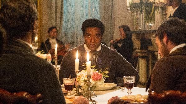 "This film publicity image released by Fox Searchlight shows Chiwetel Ejiofor in a scene from ""12 Years A Slave."" The film, by director Steve McQueen, is being hailed a masterpiece and a certain Oscar heavyweight. (AP Photo/Fox Searchlight Films, Jaap Buitendijk)"