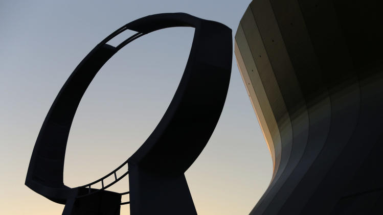 A statue depicting the Vince Lombardi Super Bowl Trophy stands outside the Mercedes-Benz Superdome at sunset on Friday, Feb. 1, 2013, in New Orleans. The Baltimore Ravens are to play the San Francisco 49ers in NFL football's Super Bowl XLVII on Sunday at the Superdome. (AP Photo/Gene J. Puskar)