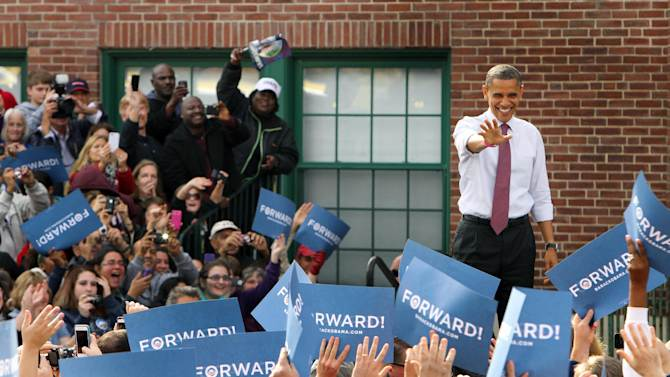 President Barack Obama arrives for a campaign event at Elm Street Middle School, Saturday, Oct. 27, 2012 in Nashua, N.H. (AP Photo/Jim Cole)