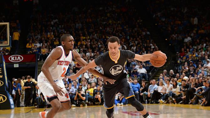 Curry dazzles on 27th birthday to lead Warriors past Knicks