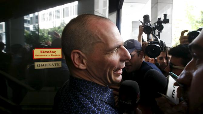 Former Greek Finance Minister Varoufakis addresses the media as he arrives at the Finance Ministry in Athens