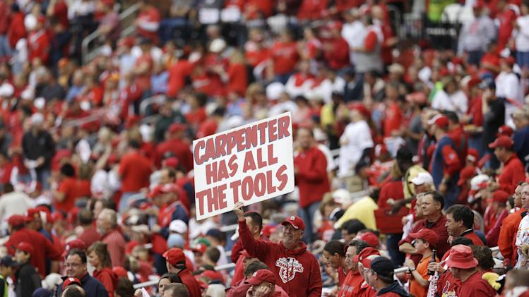 A fan holds up a sign during the fourth inning of Game 3 of baseball's National League championship series between the St. Louis Cardinals and the San Francisco Giants, Wednesday, Oct. 17, 2012, in St. Louis. (AP Photo/Patrick Semansky)