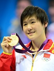 Gold medalist China's Ye Shiwen celebrates on the podium after the women's 200m individual medley final, during the swimming event at the London 2012 Olympic Games, on July 31, in London