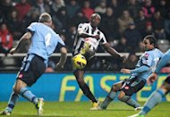 Newcastle's striker Shola Ameobi (2nd L) scores during their English Premier League football match against Queens Park Rangers at St James' Park in Newcastle, north-east England on December 22, 2012. Newcastle won the game 1-0