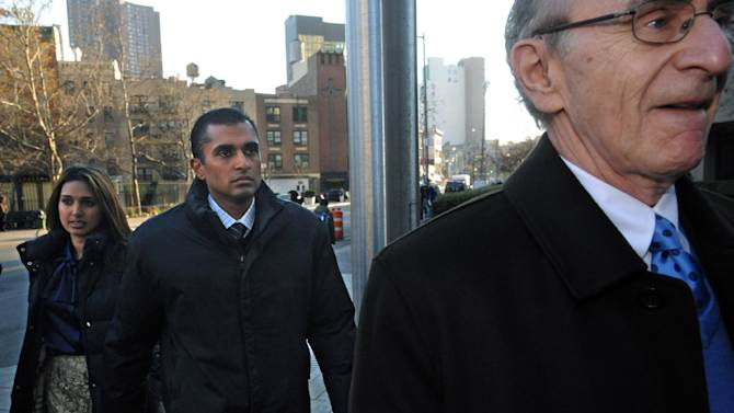Mathew Martoma, center, former SAC Capital Advisors hedge fund portfolio manager enters Manhattan federal court with his attorney Charles Skillman, Monday, Nov. 26, 2012, in New York. Martoma was arrested on charges that he helped carry out the most lucrative insider trading scheme in U.S. history, enabling investment advisers and their hedge funds to make more than $276 million in illegal profits. (AP Photo/ Louis Lanzano)