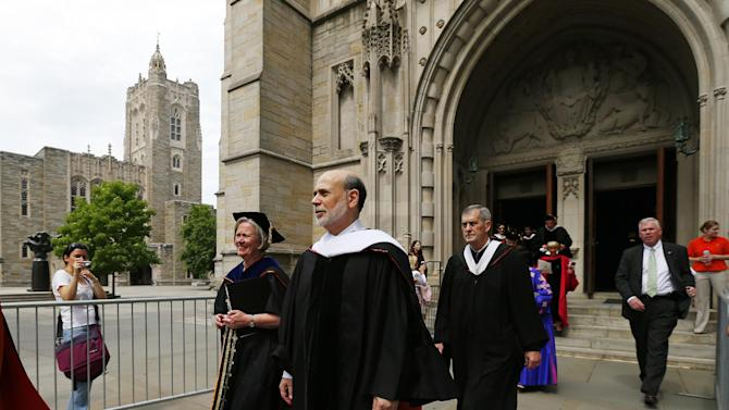 Ben S. Bernanke, Chairman of the Federal Reserve leads the processional out of Princeton University Chapel after giving the Baccalaureate address during an interfaith service in Princeton, N.J. Sunday, June 2, 2013. At left is outgoing Princeton President Dr. Shirley Tilghman, (AP Photo/Rich Schultz)