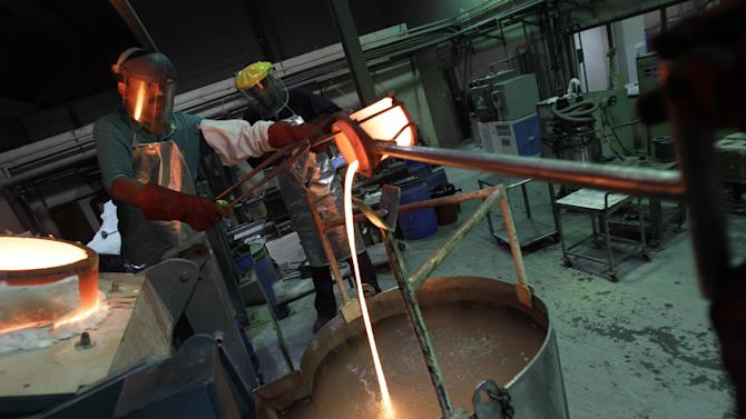 In this Tuesday Oct. 9, 2012 photo, strings of melted gold with a temperature of about 1050 degrees centigrade are poured into cooling water bath from a furnace at the Emirates Gold company in Dubai, United Arab Emirates. The emirate has set up gold refineries, vaults and jewelry-making facilities, importing gold -- including scrap from India -- and melting it down to produce gold bars. (AP Photo/Kamran Jebreili)