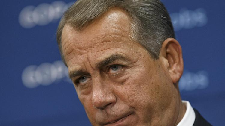 House Speaker John Boehner, of Ohio, and GOP leaders face reporters on Capitol Hill in Washington, Tuesday, Jan. 14, 2014, after a weekly House Republican Conference meeting. The Republicans tied the recent stagnant employment reports to the policies of President Barack Obama and Democratic lawmakers. (AP Photo/J. Scott Applewhite)
