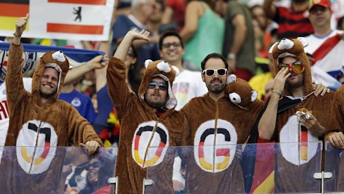 German fans wear bear outfits in the stands before the group G World Cup soccer match between Germany and Portugal at the Arena Fonte Nova in Salvador, Brazil, Monday, June 16, 2014