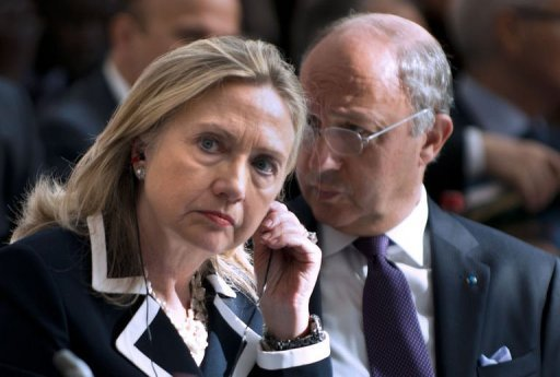 "US Secretary of State Hillary Clinton and French Foreign Minister Laurent Fabius attend the ""Friends of the Syrian People"" conference in Paris. Clinton has urged the UN to use the threat of sanctions to force change in Syria as President Bashar al-Assad was rocked by the defection of one of his most senior generals"
