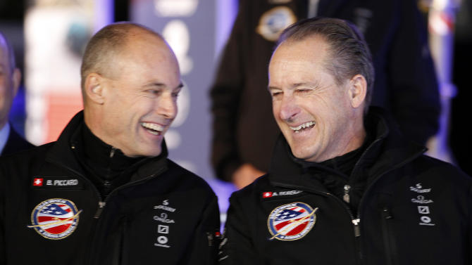 Bertrand Piccard, left, Solar Impulse Initiator, Chairman and Pilot and André Borschberg, right, Solar Impulse Co-Founder, CEO and Pilot, smile during a press conference with the Solar Impulse solar-powered plane at Moffett Airfield, NASA Ames Research Center in Mountain View, Calif., on Thursday, March 28, 2013.  A solar-powered plane that has wowed aviation fans in Europe is set to travel across the United States with stops in Phoenix, Dallas, Washington, D.C., and New York, organizers of the trip announced Thursday.   (AP Photo/Tony Avelar)