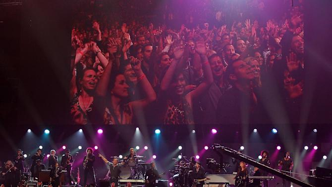 This image released by Starpix shows Bruce Springsteen and the E Street Band performing at the 12-12-12 The Concert for Sandy Relief at Madison Square Garden in New York on Wednesday, Dec. 12, 2012. Proceeds from the show will be distributed through the Robin Hood Foundation. (AP Photo/Starpix, Dave Allocca)
