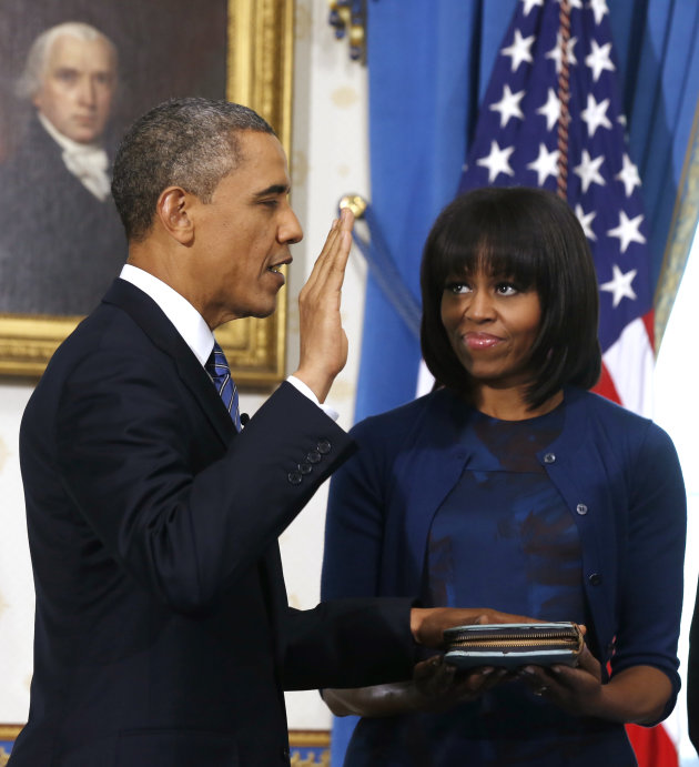 President Barack Obama is officially sworn-in by Chief Justice John Roberts in the Blue Room of the White House during the 57th Presidential Inauguration in Washington, Sunday Jan. 20, 2013, as first